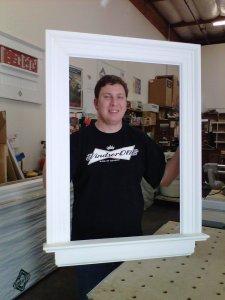 "Dan ""sample man' Hetzer getting his Huttig poster frames on!!"